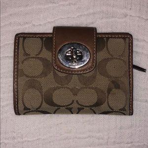 Small tan Signature C Coach wallet